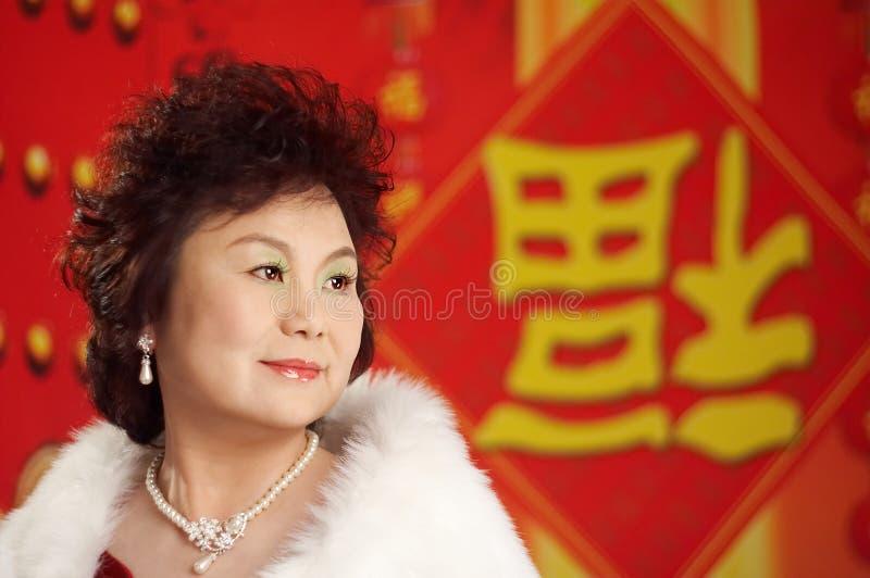 Aziatische vrouw die nieuw jaar zegent stock afbeeldingen