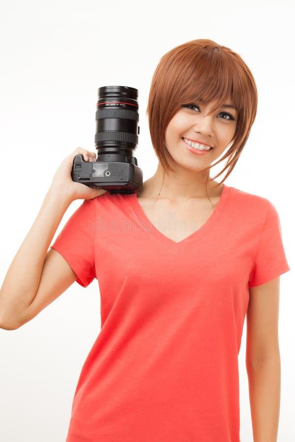 Aziatische vrouw en camera stock fotografie