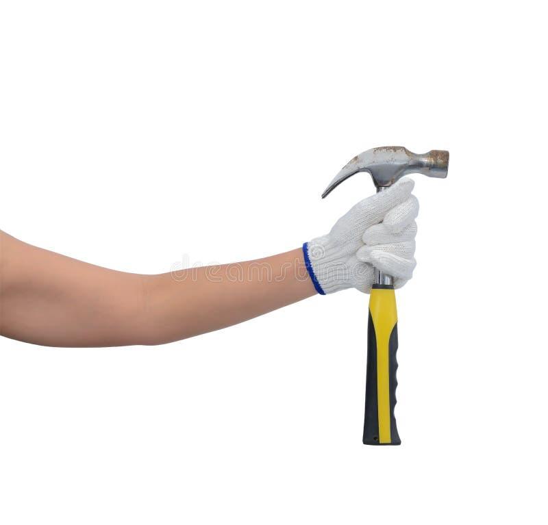 Aziatische vrouwenarbeider met beschermende die de holdingshamer van de handschoenenhand op wit wordt geïsoleerd stock afbeelding