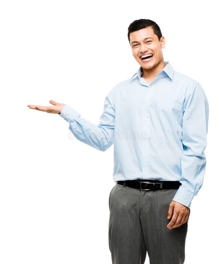 Aziatische zakenman die lege die exemplaarruimte tonen op witte bac wordt geïsoleerd stock foto