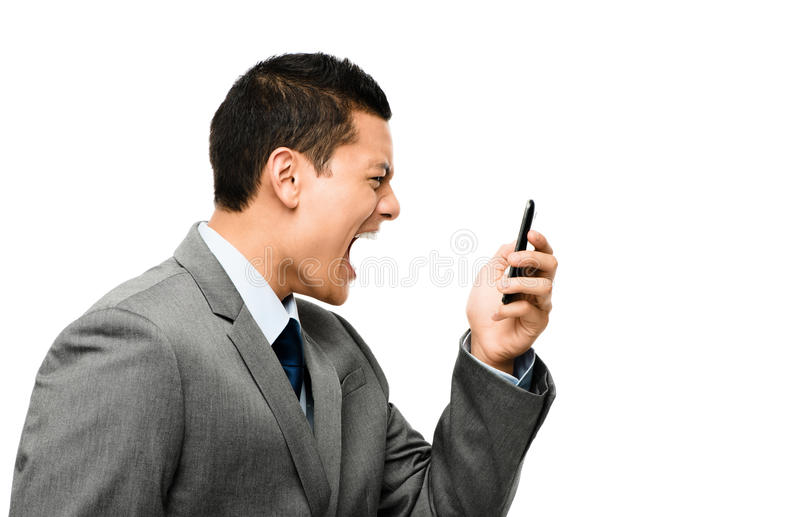 Aziatische zakenman die in telefoon schreeuwt royalty-vrije stock afbeeldingen