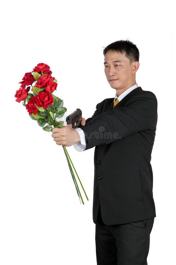Aziatische Zakenman Standing met het Houden van een Boeket van Rose Flower stock afbeelding
