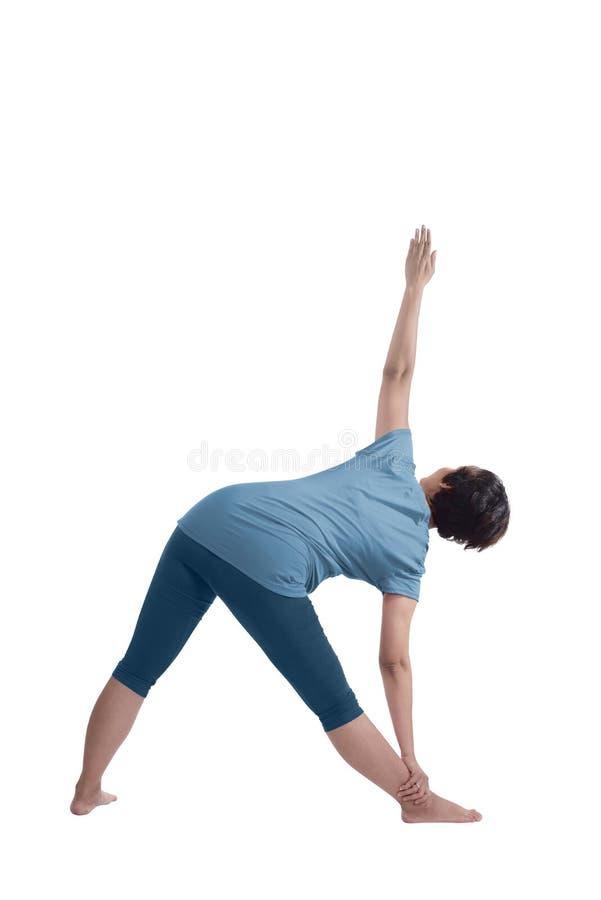 Aziatische zwangere moeder die yoga doen stock afbeelding