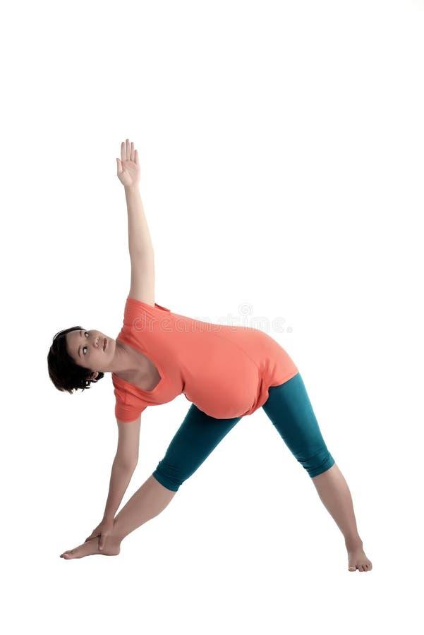 Aziatische Zwangere Vrouw die Yoga doen royalty-vrije stock foto's