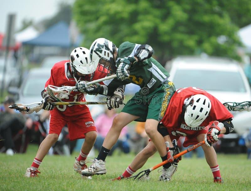 Azione di lacrosse della gioventù fotografia stock