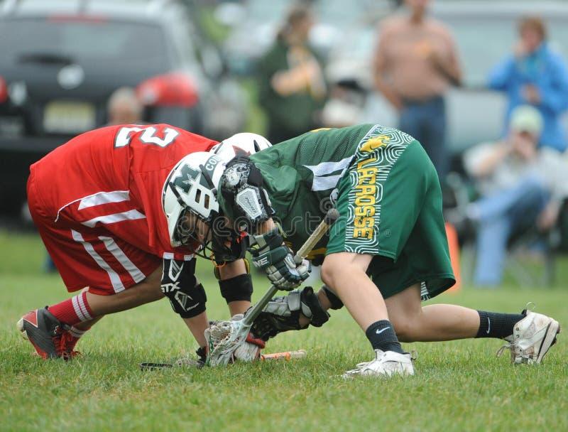 Azione di lacrosse della gioventù immagine stock