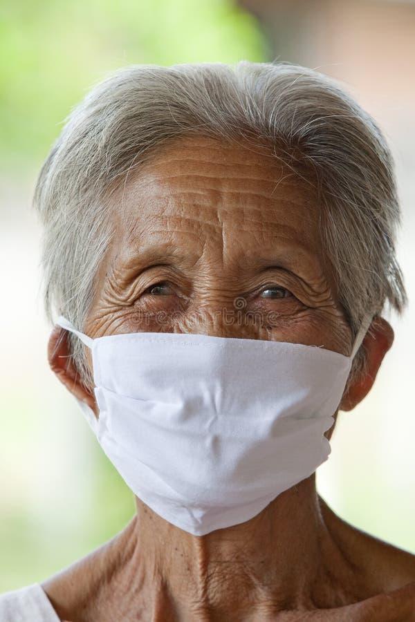 azjata kobieta maskowa stara ochronna obrazy stock
