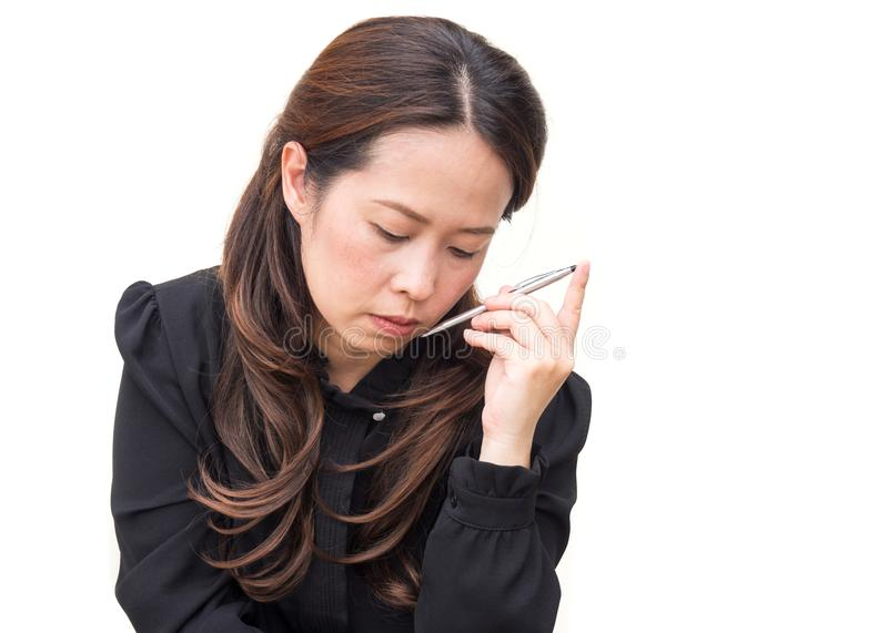 Azjatycka biznesowa kobieta na bielu odizolowywa tło Akcja w cienkim zdjęcia royalty free