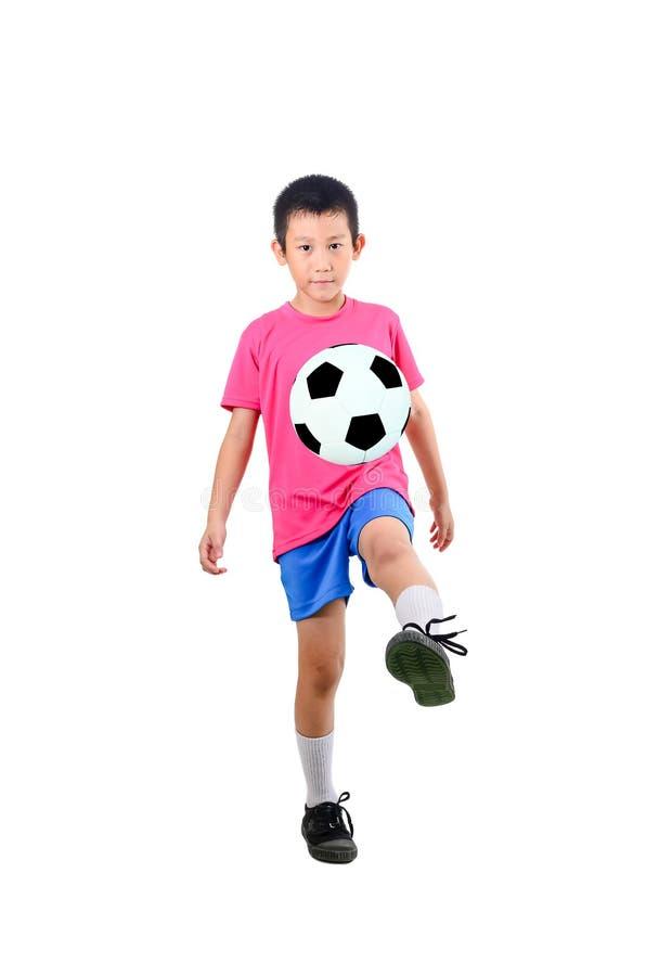 Azjatycka chłopiec z piłki nożnej piłką obraz stock