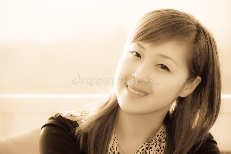 Azjatycka dziewczyna uśmiechnięta twarz zdjęcie stock