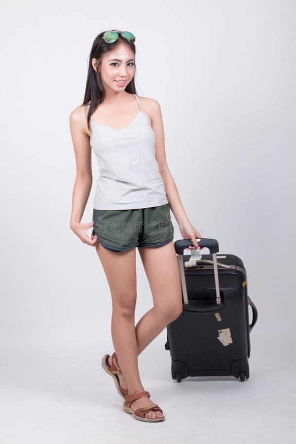 Azjatycka dziewczyna w podróży pojęciu obrazy stock