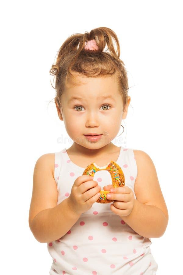 Azjatycka dziewczyna z pączkiem zdjęcia stock