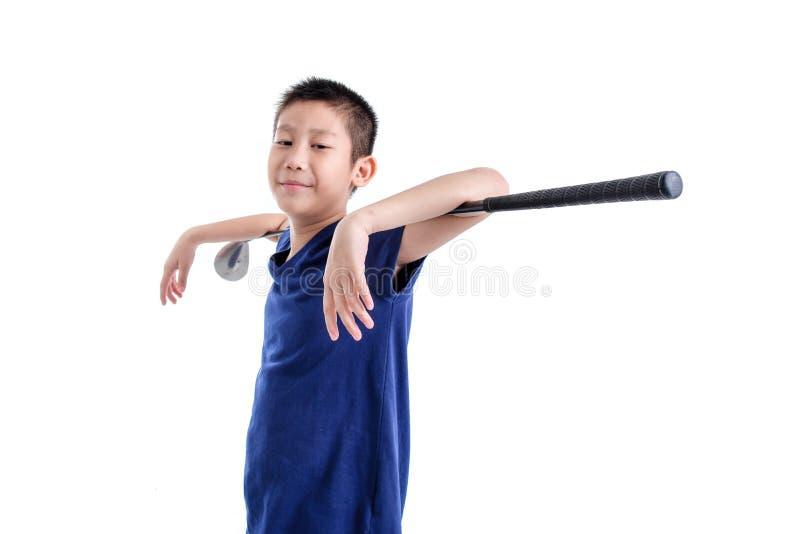 Azjatycka golfista chłopiec na bielu zdjęcie royalty free