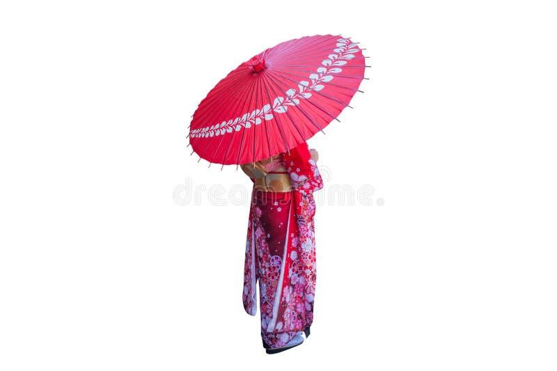 Azjatycka kobieta jest ubranym japońskiego tradycyjnego kimono z parasolem na białym tle obraz stock