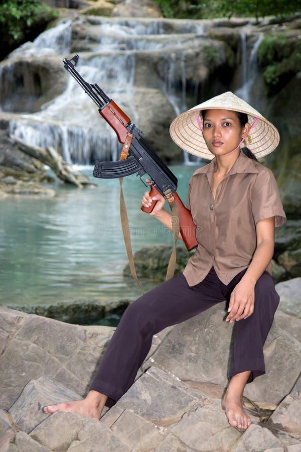 Azjatycka kobieta zbrojąca zdjęcia stock