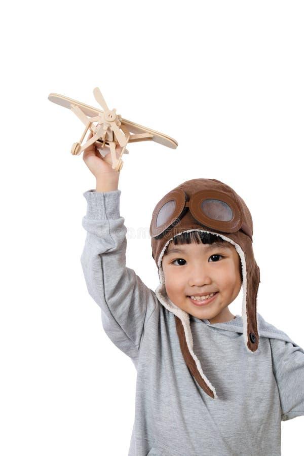 Azjatycka Mała Chińska dziewczyna Bawić się z Zabawkarskim samolotem obrazy stock