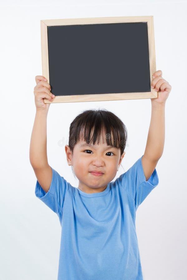 Azjatycka Mała Chińska dziewczyna Trzyma Blackboard fotografia stock