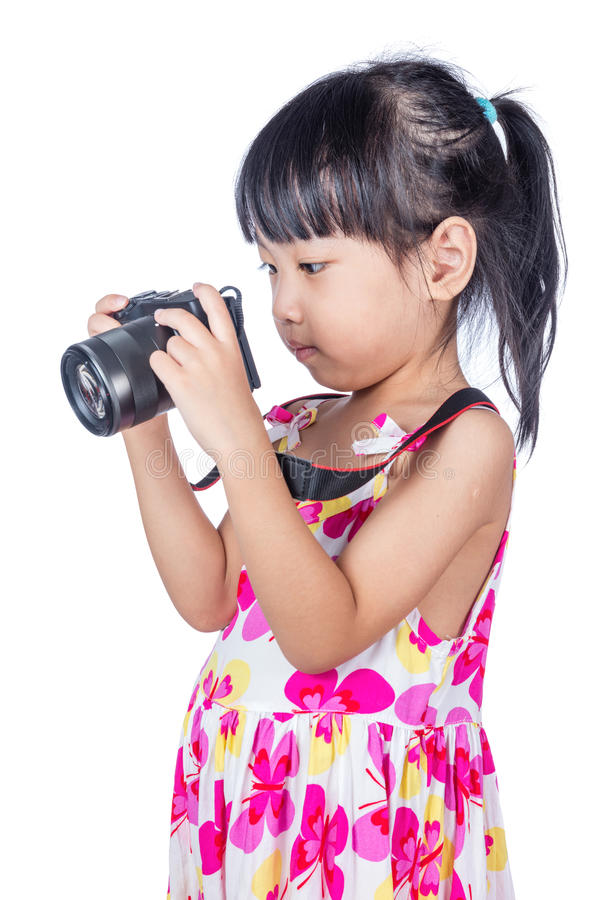 Azjatycka Mała Chińska dziewczyna trzyma kamerę fotografia royalty free