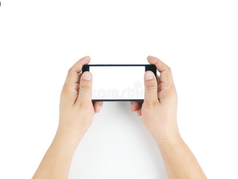 Azjatycka ręka horyzontalna trzymający czarnego smartphone fotografia royalty free