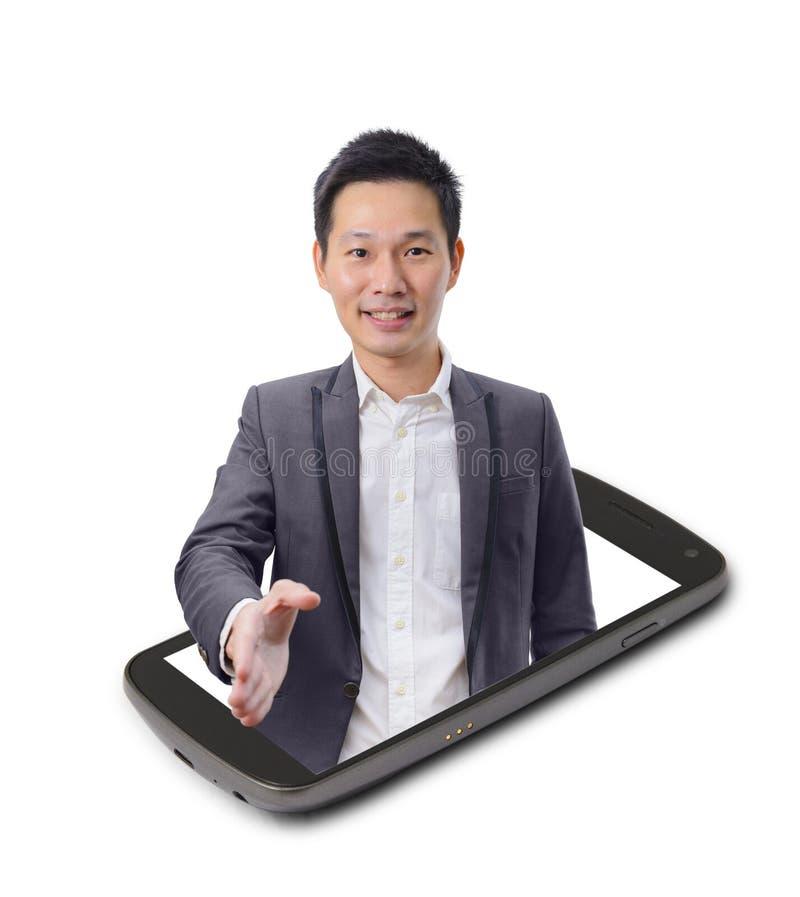 Azjatycki biznesmen daje uściskowi dłoni na smartphone ekranie obraz stock