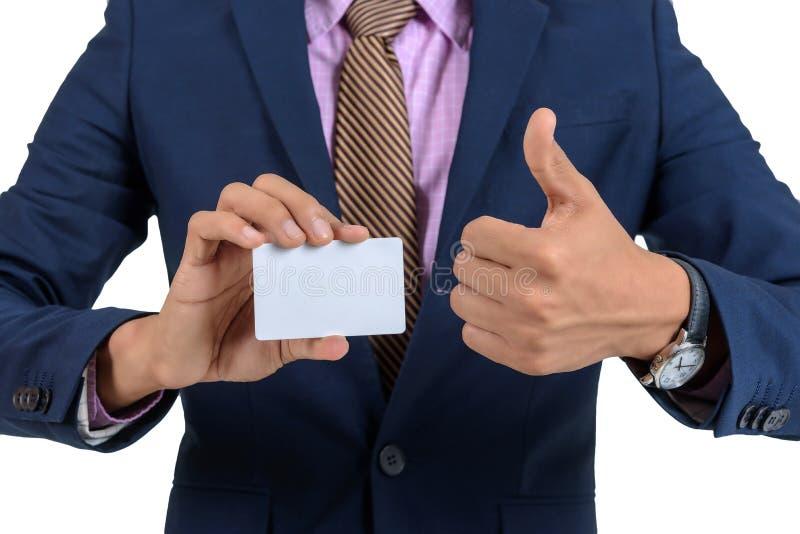 Azjatycki biznesmen pokazuje pustą kartę ręki I podwyżki kciukami Dalej obraz royalty free