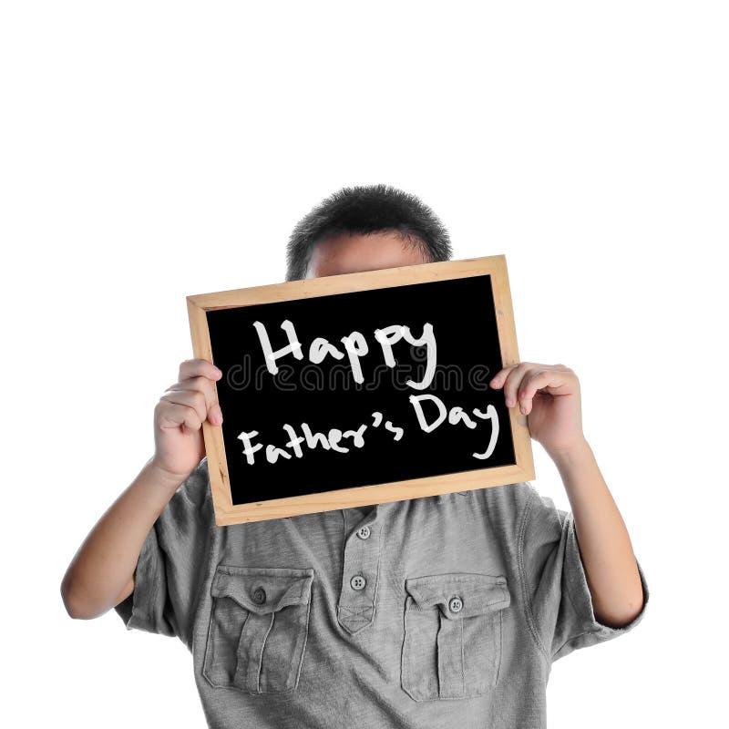 Azjatycki chłopiec mienie z szczęśliwym ojca dniem obraz royalty free