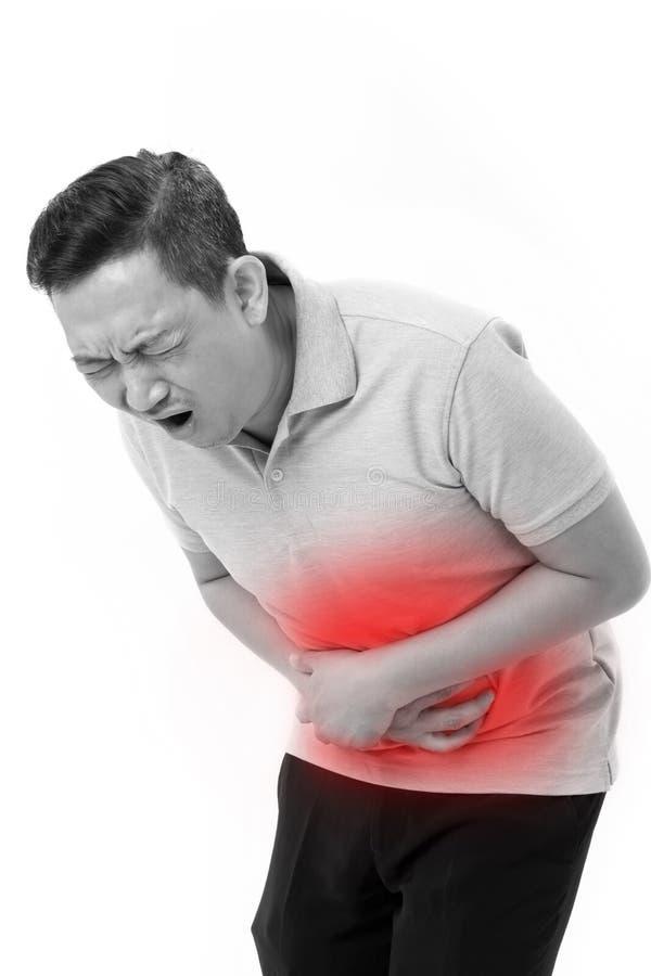Azjatycki mężczyzna cierpienie od stomachache, zaparcie, niestrawność, zdjęcia royalty free
