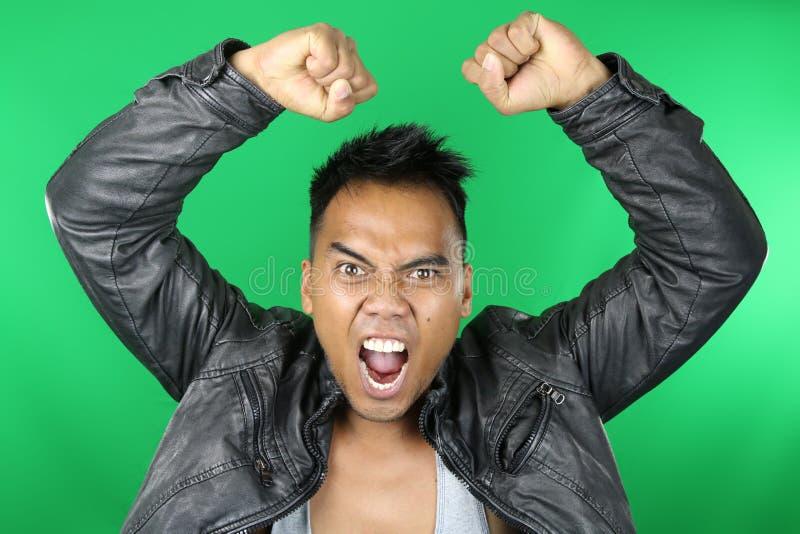 Azjatycki mężczyzna krzyczeć obrazy stock