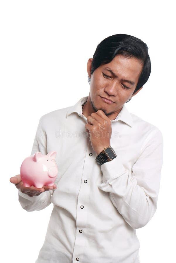 Azjatycki mężczyzna Z prosiątko bankiem obraz royalty free