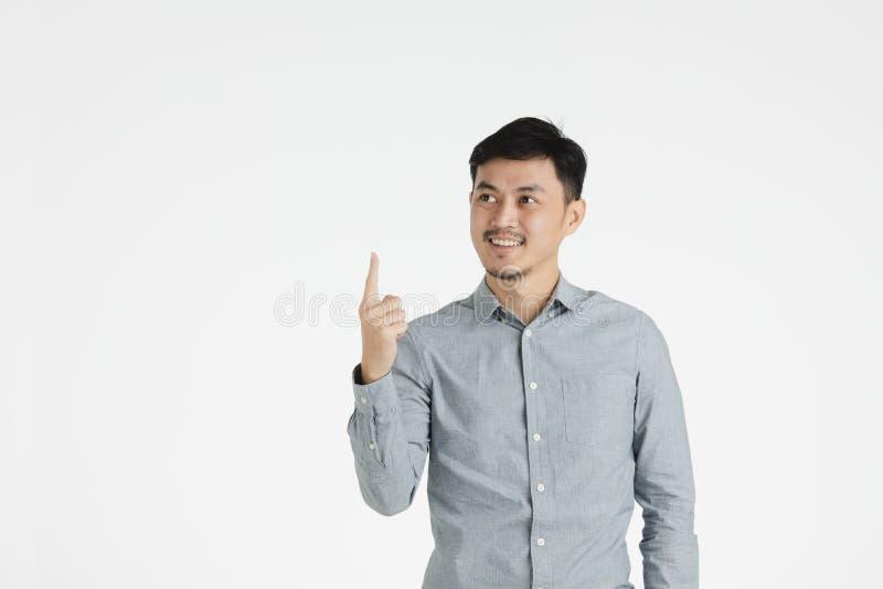Azjatycki młody człowiek klika dalej pomysł obrazy stock