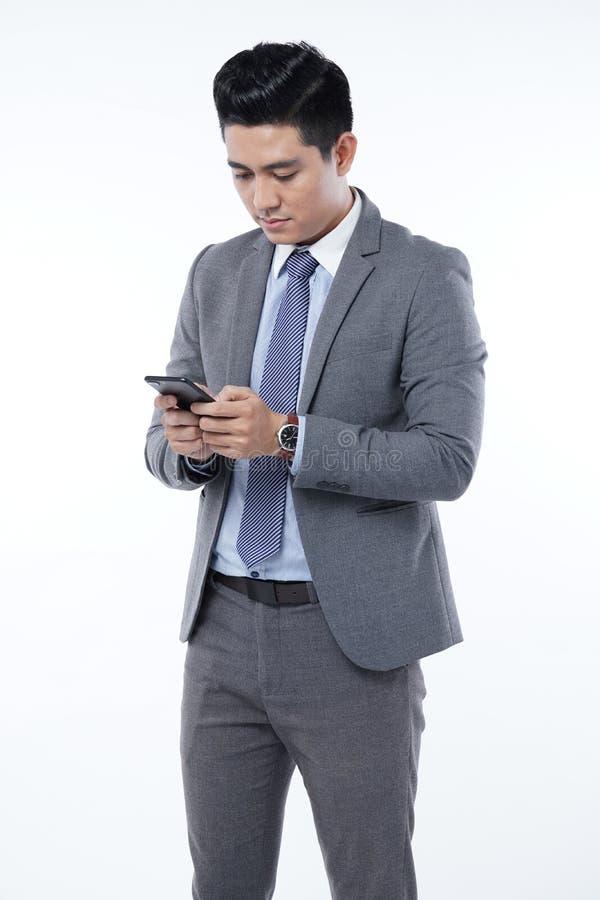 Azjatycki Przystojny Młody Biznesowy mężczyzna Odizolowywający na Białym tle obraz stock
