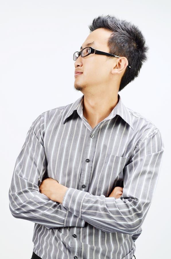 Azjatyckiego biznesmena przyglądająca strona zdjęcie stock