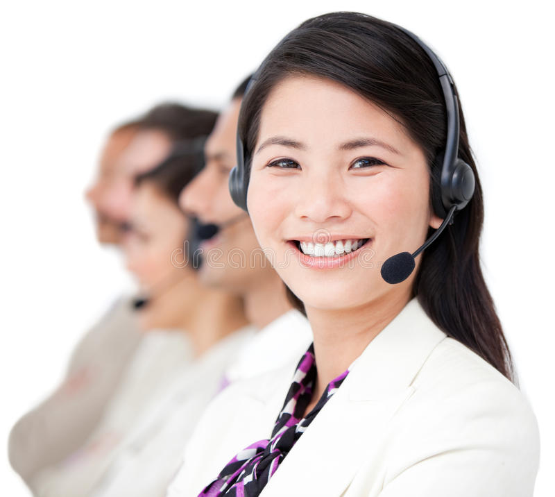 azjatykci bizneswomanu zakończenia earpiece azjatykci obraz stock