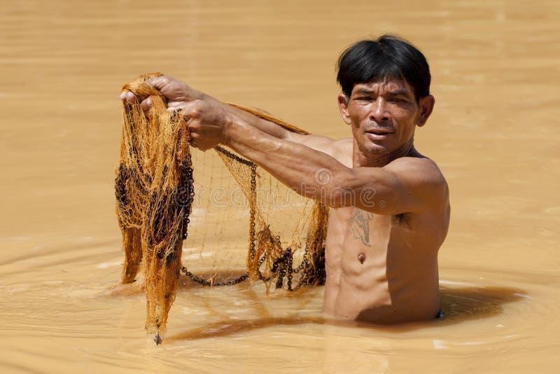 azjatykci rybaka sieci rzut zdjęcia stock