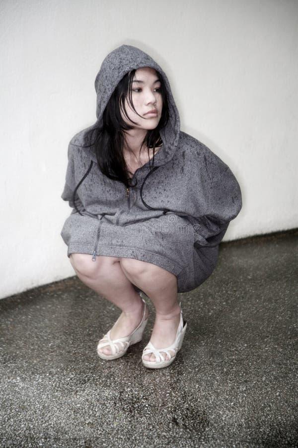 azjatykciej dziewczyny kapturzasta kurtka obrazy royalty free