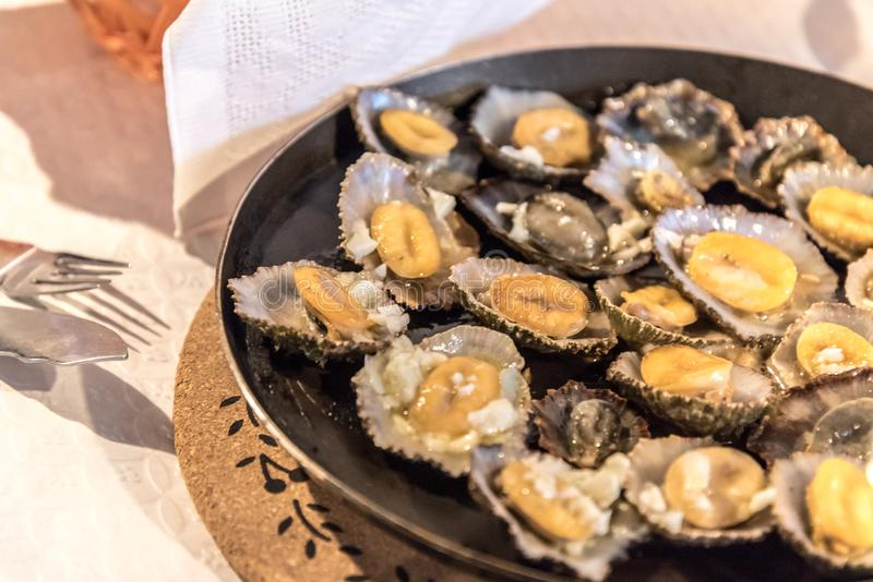 Limpets served in a restaurant in Mosteiros on the island of Sao Miguel in the Azores, Portugal royalty free stock photo