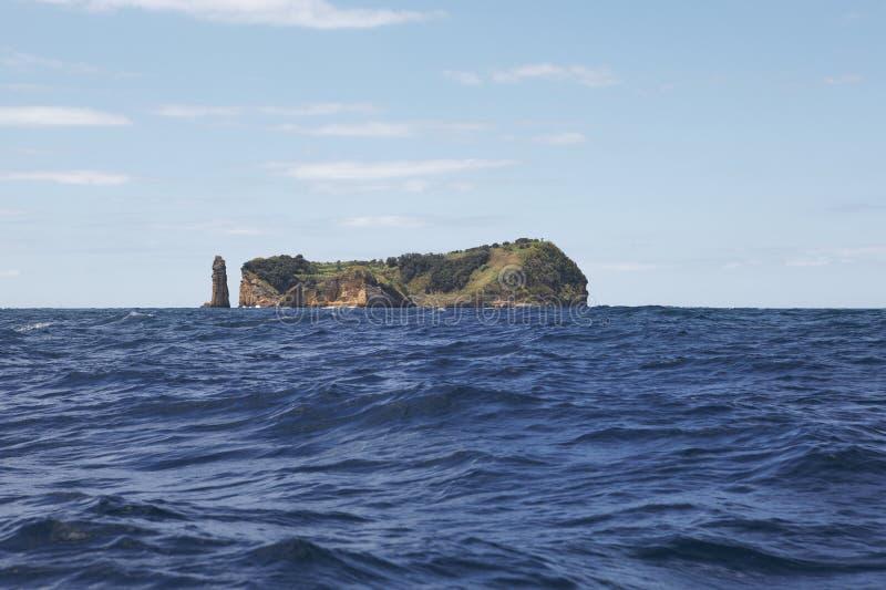 Azores coastline landscape with volcanic island. Ilheu da Vila. royalty free stock photos