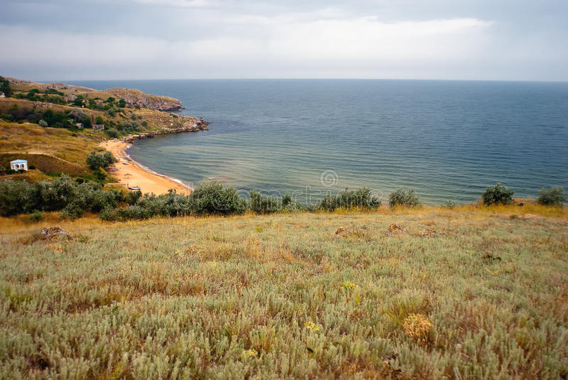 Azov landscape. The landscape of dry grass field and Azov sea stock photography