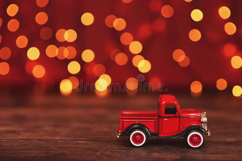 Azov, Russia, 31-July 2019. Red car carrying a Christmas fir tree on the snow background. Concept for Merry Christmas and Winter stock photo