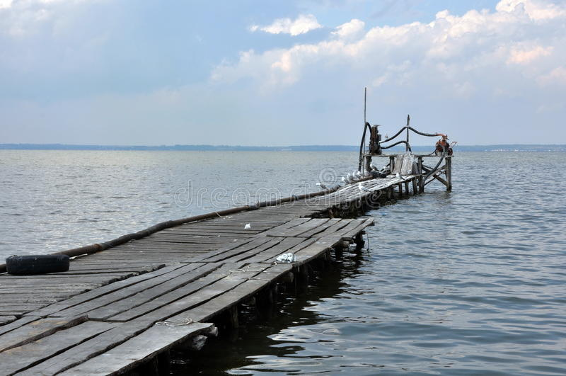 Azov Sea, old wooden pier. The Azov Sea, the old wooden pier, a seagull stock image