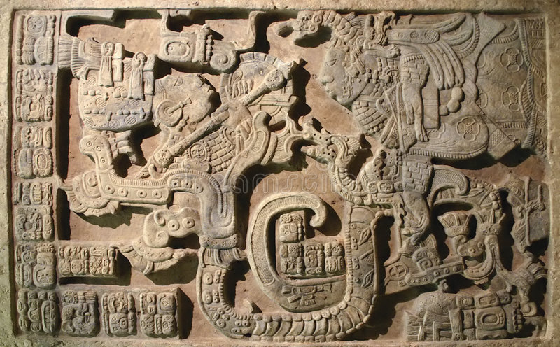 Aztec art. Example of Aztec sculpture. Relief work on stone with mythological battle royalty free stock images