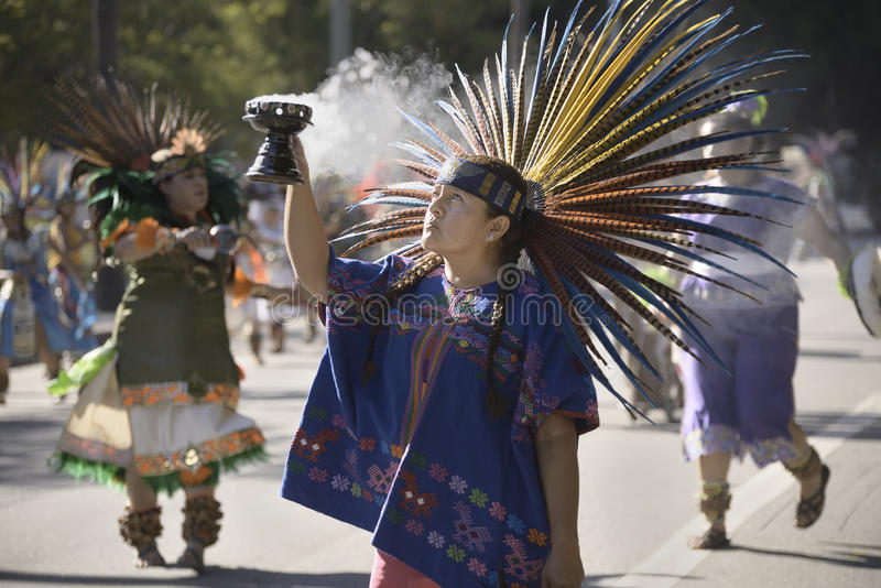 Aztec dancers. Dressed in traditional costumes participate in the Grand Marian Procession through downtown Los Angeles stock photos
