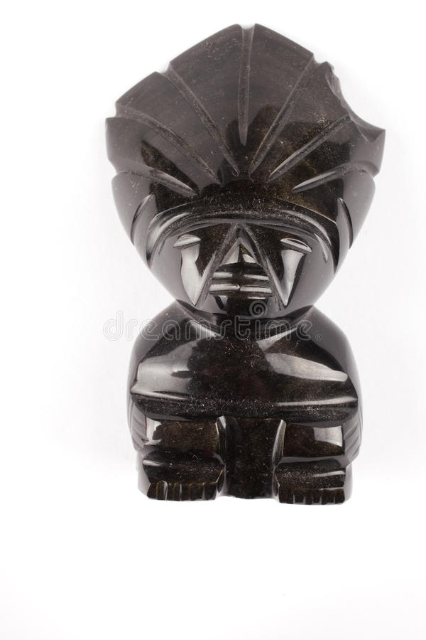 Aztec head. Black stone from south america stock images