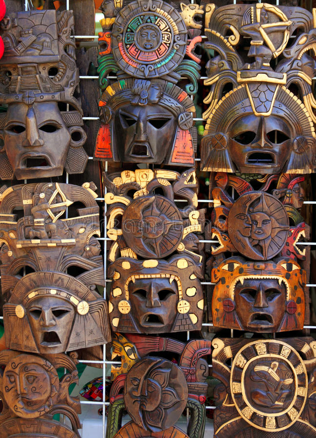 Aztec mayan wooden indian mask handcrafts. Aztec mayan wooden Mexican indian mask handcrafts in rows stock images