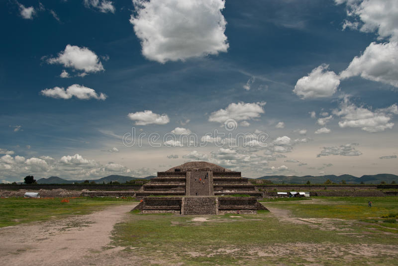 Aztec pyramid with mountains panorama. An Aztec pyramid La Ciudadela in Teotihuacan, Mexico royalty free stock photo