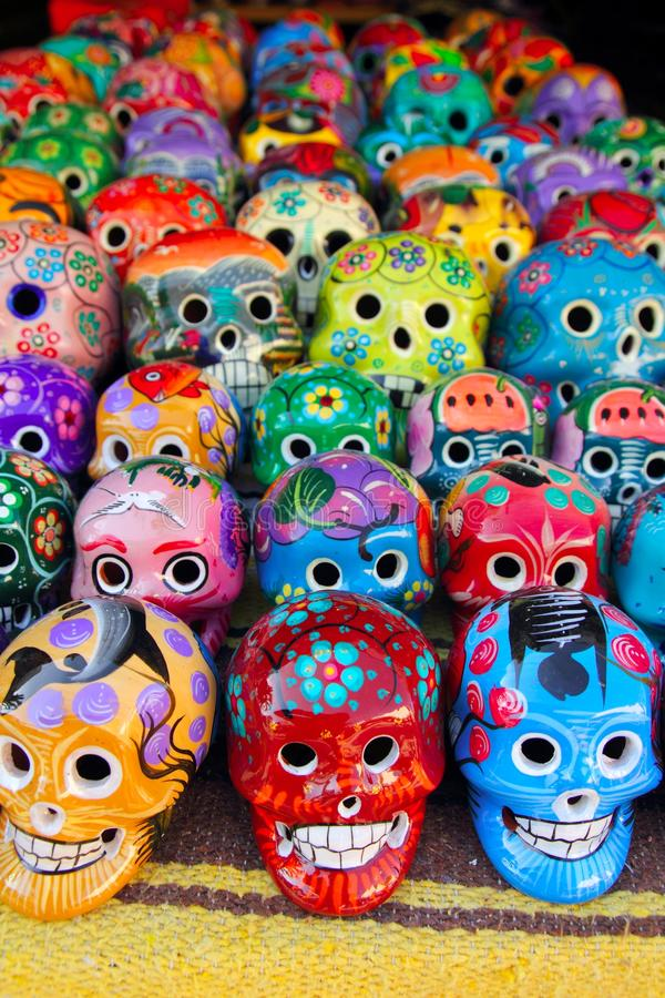 Aztec skulls Mexican Day of the Dead colorful. Aztec colorful skulls handcrafts from Mexican Day of the Dead stock image