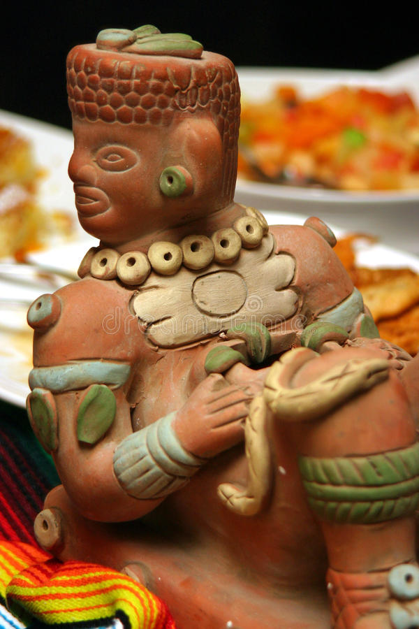 Aztec statue. A aztec statue on a table stock images