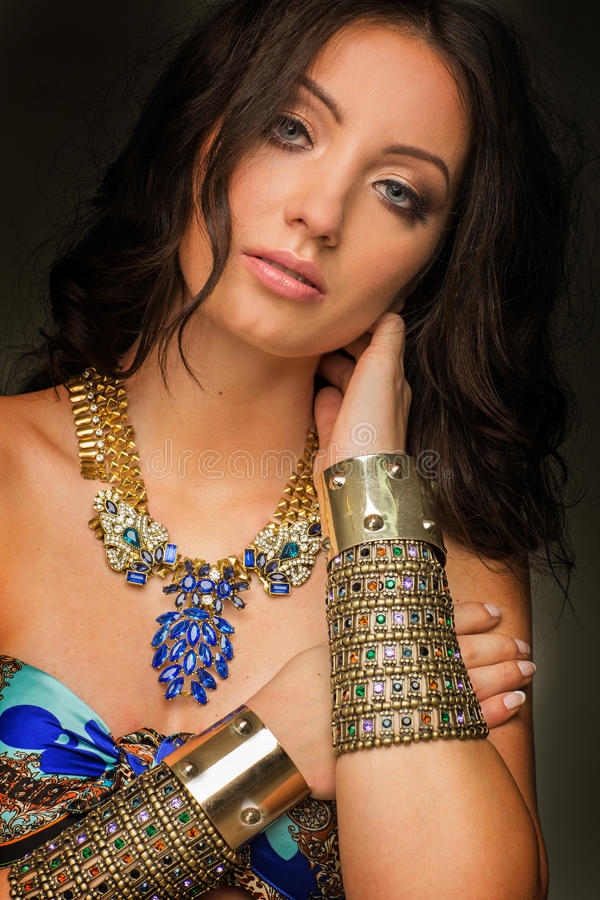 Aztec women wearing gold jewellery royalty free stock image
