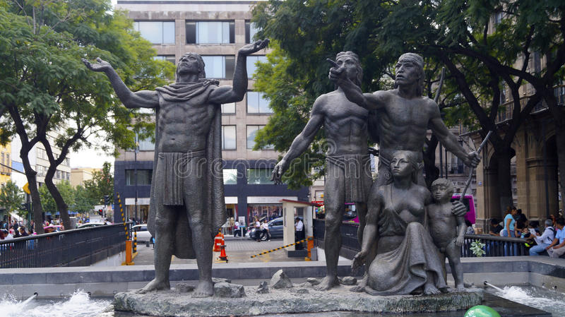 Aztecs discover the place for his new city sculpture. A sculpture in the centre of mexico capital city, shows the moment when aztec people find an eagle eaten a stock photography