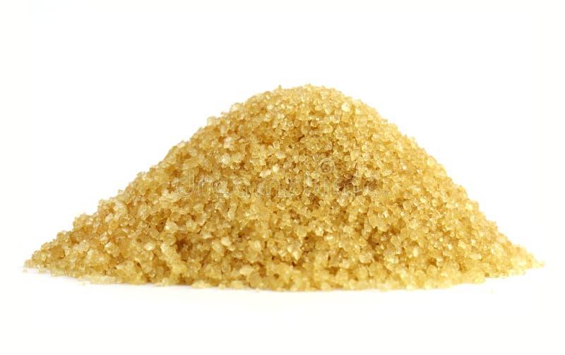Azucare el montón, amarillo del azúcar granulado de la forma de la montaña del azúcar, pila de azúcar marrón de la caña de la cañ foto de archivo